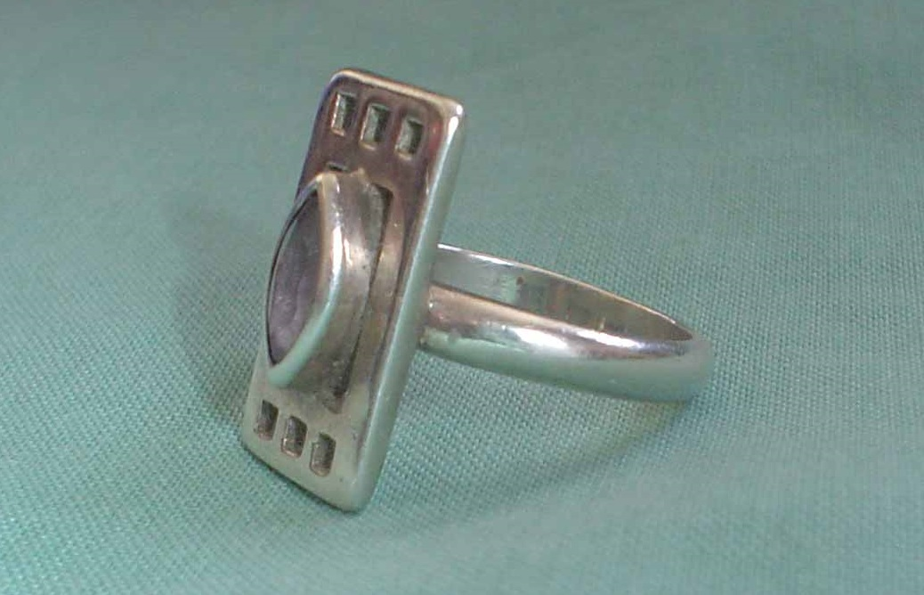 679b35127 mackamethystring3. A sterling silver ring in the style of Charles Rennie  Mackintosh